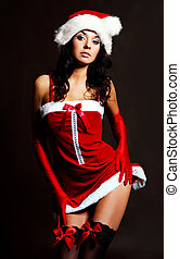 sexy girl dressed as Santa - studio portrait of a sexy young...