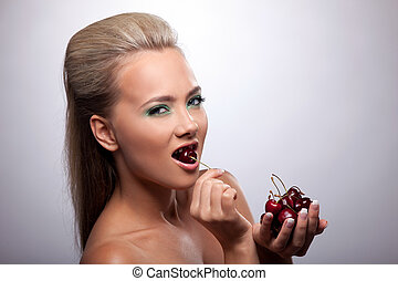 Sexy girl eat cherry look at camera