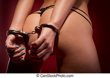 sexy girl from behind in handcuffs - sexy buttocks and hands...