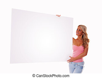 sexy girl holding a billboard add isolated over a white background