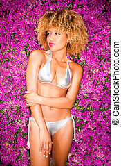 Sexy Girl in Bikini Posing On Flower Background