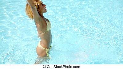 Sexy Girl in Bikini Splashing Water