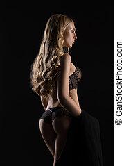 Sexy girl in luxurious lace underwear in studio