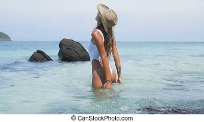 Sexy girl in paradise tropical beach - Pretty brunette woman...