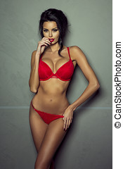 Sexy girl in red lingerie.