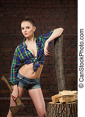 girl in shirt chopping wood with an ax