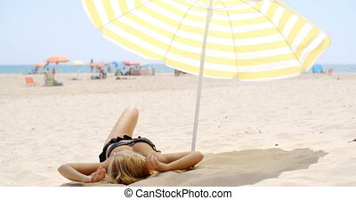 Getting Some Tan - Sexy Girl is Getting Some Tan on the...