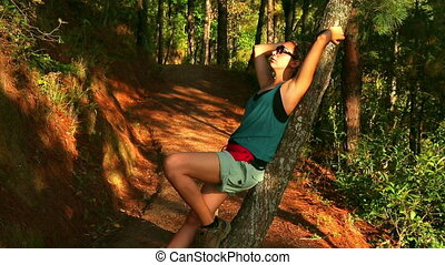 sexy girl leaning tree, posing