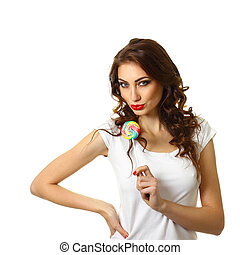 sexy girl licking a lollipop. Beautiful woman with creative makeup holding a candy. pretty smiling brunette girl with a lollipop in her hand