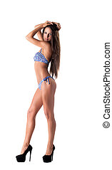 Sexy girl posing in blue bikini, looking at camera