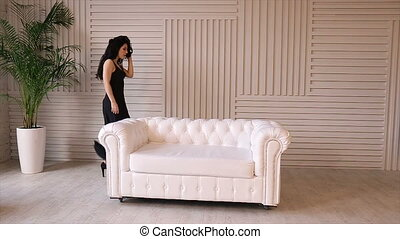 Sexy girl posing in white leather sofa.Full hd video