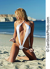 Sexy girl posing on beach