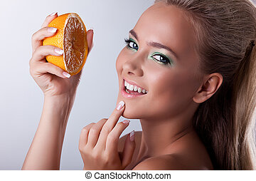 Sexy girl smile with squeeze orange
