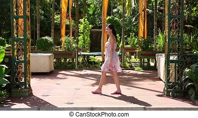 Sexy girl standing at gate