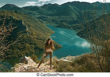Sexy girl tourist sightseeing amazing view of Rijeka Crnojevica, Montenegro. Skadar lake national park, Pavlova Strana. Viewpoint Ridge mountains panoramaic landscape.