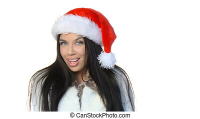 Sexy girl wearing santa claus hat sending kiss