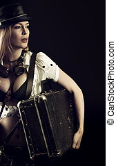 Sexy girl wearing steampunk costume with suitcase