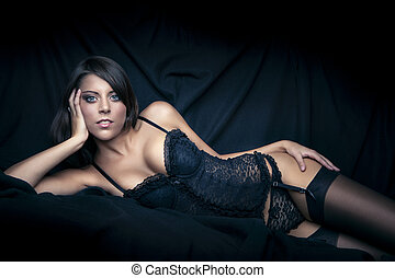 sexy girl with big breasts in black lingerie