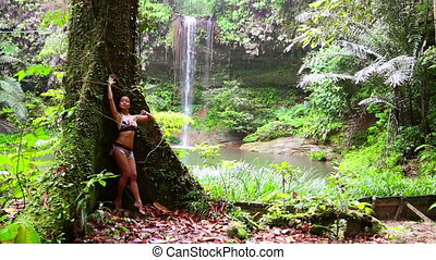 Sexy girl with bikini in forest