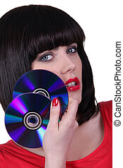 Sexy girl with CDs on white background