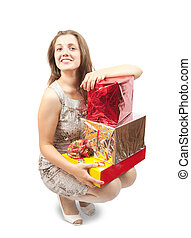 Sexy girl with present boxes