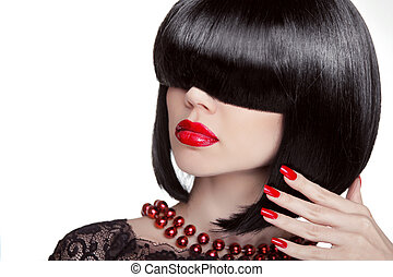 Sexy Glamour Girl. Fashion portrait of brunette woman with black hair showing red manicured polish nails and hot lips. Professional makeup and hairstyle. Model isolated on white background.