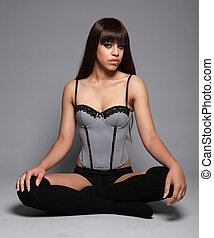 Sexy glamour model girl cross legged in lingerie