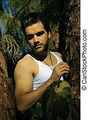 Sexy guy in tree