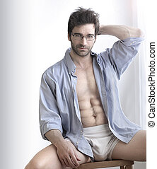 Sexy guy - Playful sexy portrait of a handsome buff man in...