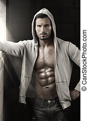Sexy guy with abs - Very sexy male model with open jacket...
