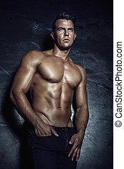 Sexy handsome man posing. - Handsome muscular man posing.