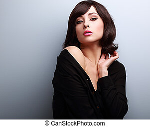 Sexy hot makeup woman with short hairstyle posing in black shirt
