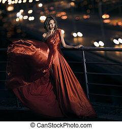 sexy, joven, belleza, mujer, en, ondear, vestido rojo