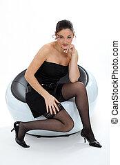 sexy, kobieta posiedzenie, w, niejaki, krzesło