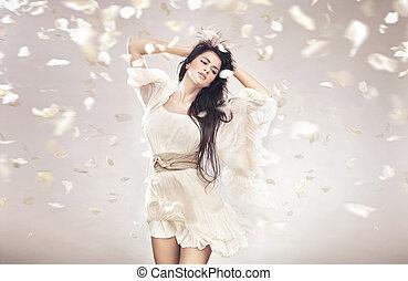 Sexy lady among petals