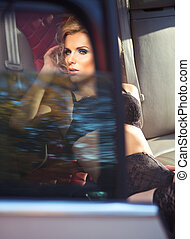 Sexy lady in a sport car