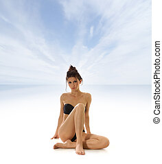 Sexy lady isolated over sea and sky background
