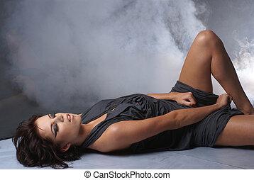 Sexy lady over smoky background