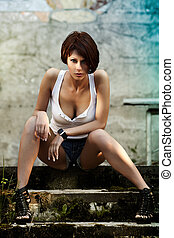 Sexy lady - Sexy brunette lady in white shirt sitting on...