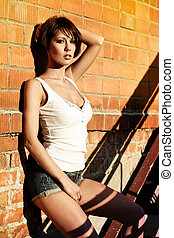 Sexy lady - Sexy brunette lady in white shirt standing near...