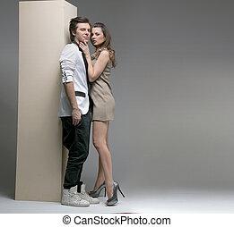 Sexy lady touching her handsome boyfriend