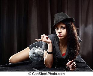 Sexy lady with shiny disco ball