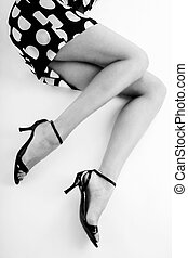 Sexy legs - Black and white shot of long slim woman legs in...