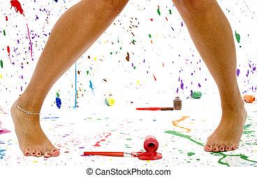 Sexy Legs - Woman\\\'s bare legs in paint splattered studio.
