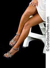Sexy legs - Woman\\\'s bare legs in high heel shoes on black...