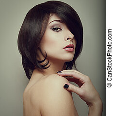 Sexy makeup woman. Black short hair style. Vintage portrait