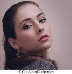 Sexy makeup woman looking hot with long lashes. Closeup portrait