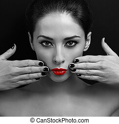 Sexy makeup woman with bright red lips showing manicured hands
