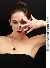 Sexy makeup woman with red lips and black manicured nails