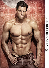 Sexy male model - Handsome muscular man posing against...